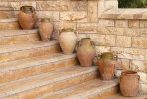 Six waterpots on stairs next to wall